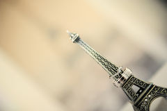Wedding rings on a statue of the Eiffel Tower. On the background image of the Eiffel Tower Royalty Free Stock Photos