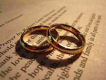 Wedding Rings on Stevenson`s Wedding Prayer. Golden wedding rings positioned on Robert Louis Stevenson`s famous Wedding Prayer Stock Photos