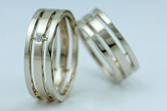 Wedding rings and stones Royalty Free Stock Photos