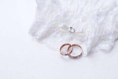 Wedding rings on a stump Stock Image