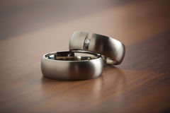 Wedding rings on the table Royalty Free Stock Image