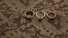 Wedding Rings on the table. Close up shoot of wedding rings. Wedding background stock video