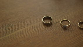 Wedding Rings on the table. Close up shoot of wedding rings. Wedding background stock footage