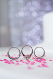 Wedding rings on table Royalty Free Stock Image