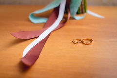 Wedding rings on table Stock Image