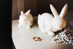 Wedding rings on the table with  hares Royalty Free Stock Photos