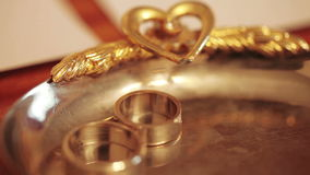 Wedding rings on table stock footage