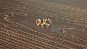 Wedding rings on the table rotation stock video