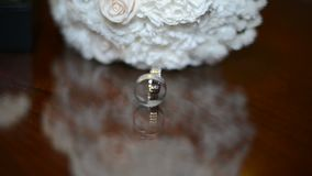 Wedding rings are on the table. Two rings on the wooden background stock video