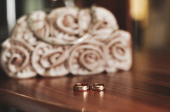 Wedding rings on the  table. Wedding rings on the varnished wooden table Stock Images