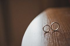 Wedding rings on a table 2294. Stock Photography