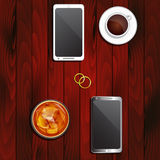 Wedding rings, telephones and drinks Royalty Free Stock Image