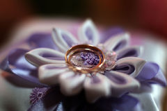 Wedding Rings on a textile flower purple Royalty Free Stock Photos