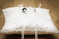 Wedding Rings Tied on Pillow Stock Photography
