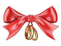 Wedding rings tied red ribbon and bow. Royalty Free Stock Photos
