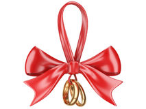 Wedding rings tied with ribbon and red bow. Royalty Free Stock Images