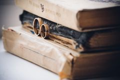 Wedding rings on top of books Stock Photography