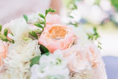 Wedding rings on top of a wedding bouquet royalty free stock image