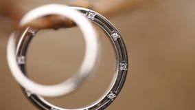 Wedding rings on a tree branch. Macro lens stock video footage
