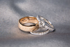 Wedding rings. Two wedding rings with diamond on platinum rings Royalty Free Stock Photography