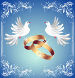 Wedding rings and two doves. Card with wedding rings and two doves in ornament frame Stock Images
