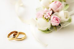 Wedding rings. Two golden wedding rings and flowers Stock Image