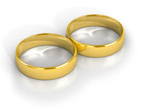 Wedding Rings. Two golden wedding rings isolated on white background Royalty Free Stock Photo