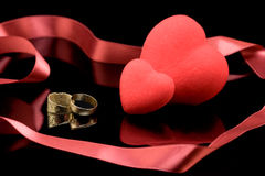 Wedding rings and two hearts Stock Photo
