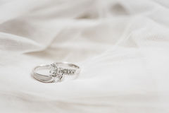 Wedding rings. Two wedding rings on white cloth Royalty Free Stock Images