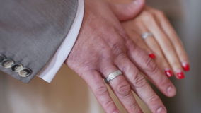 Wedding rings. Two white people groom and bride with wedding rings stock video
