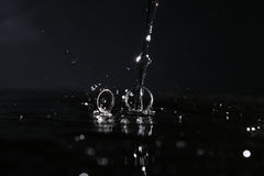 Wedding rings under drops of water Royalty Free Stock Photo