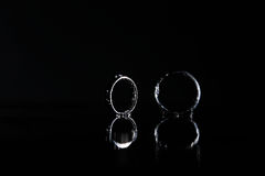 Wedding rings under drops of water Stock Photo