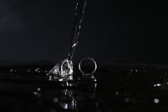 Wedding rings under drops of water Royalty Free Stock Photos