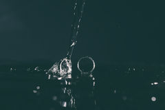 Wedding rings under drops of water Royalty Free Stock Photography