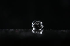 Wedding rings under drops of water Royalty Free Stock Images