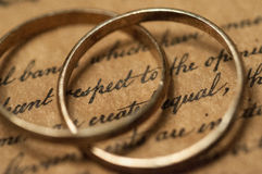 Wedding rings on the US Constitution Royalty Free Stock Image