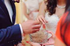 Wedding Rings and Vase with Grain Stock Photo