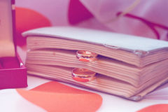 Wedding rings. With a vintage book Royalty Free Stock Image