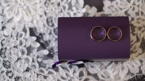 Wedding rings on violet box. Shot stock video footage