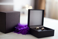 Wedding rings with violet decorative feather Stock Photo