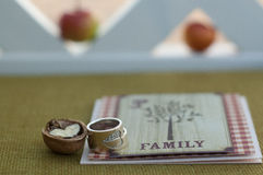Wedding rings walnuts card Stock Image