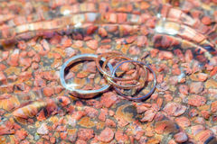 Wedding rings in the water Royalty Free Stock Image