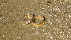 Wedding rings sea stock video