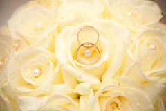 Wedding rings and wedding bouquet. Stock Photos