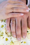 Wedding rings and wedding bouquet. Stock Images