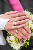 Wedding rings and wedding bouquet. Stock Image