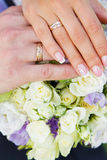 Wedding rings and wedding bouquet. Stock Photography