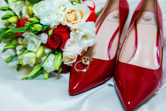 Wedding rings and wedding bouquet  on a white background Stock Photo