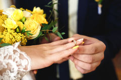 Wedding rings, wedding ceremony, ring on bride`s hand Stock Images