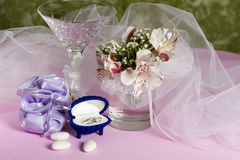Wedding rings and wedding favors. On a colorful background Stock Photos